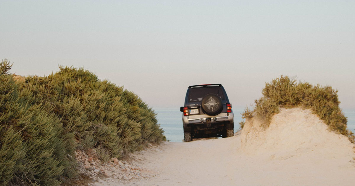 jeep driving on beach