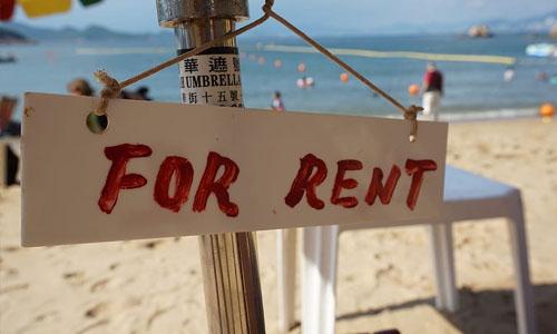 beach house rental sign