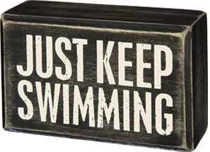 just keep swimming beach sign